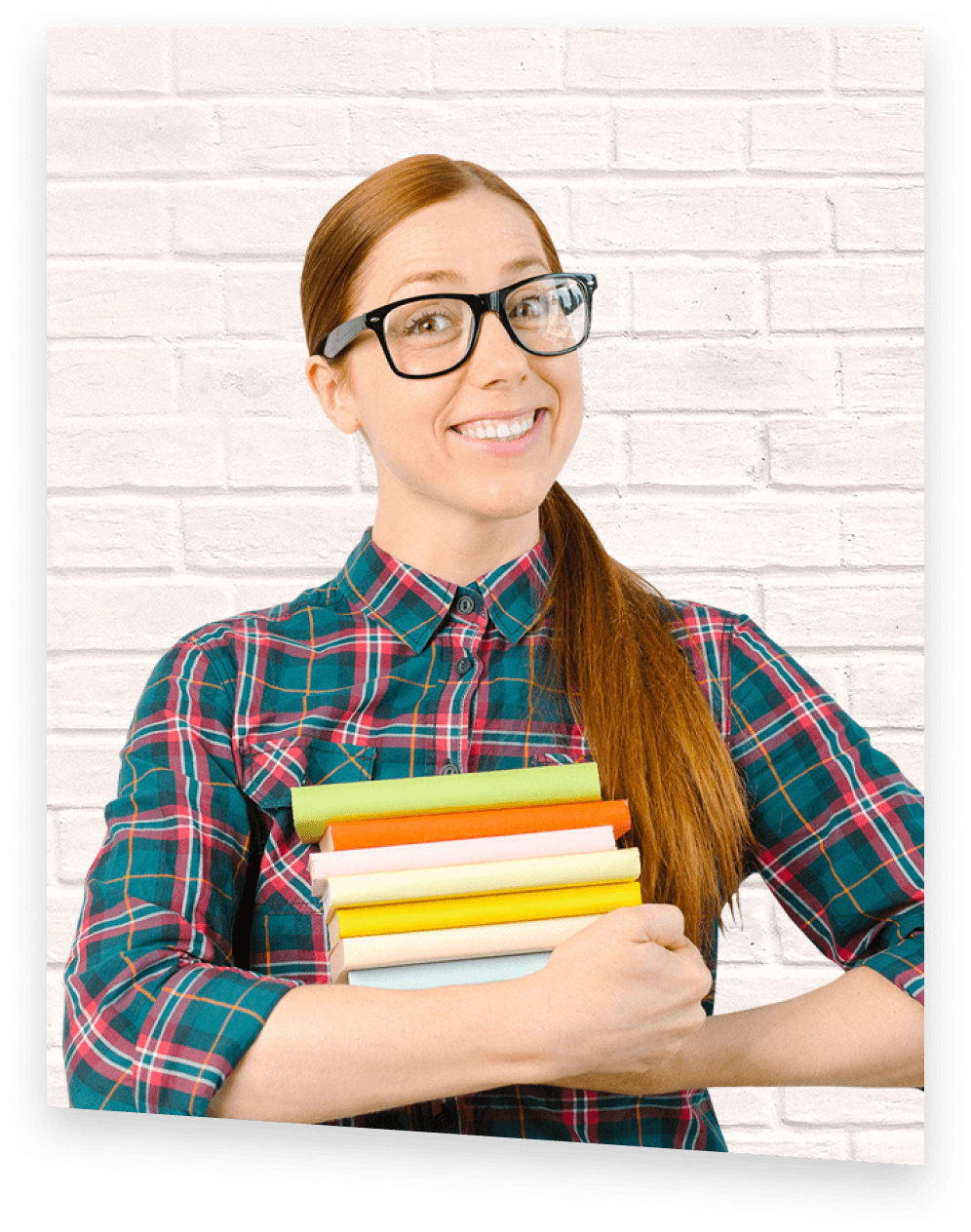 AP Prep tutor smiling, holding a stack of books with both arms